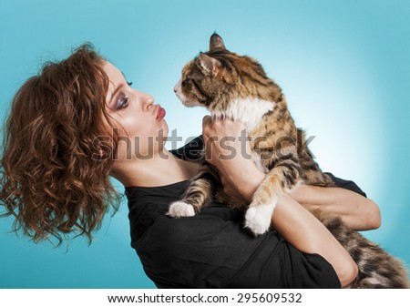 Cute and funny girl and cat portrait - stock photo