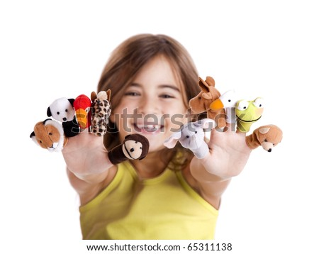 Cute and happy girl playing with finger puppets - stock photo