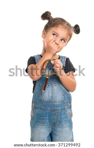 Cute and thoughtful baby girl  with magnifying glass  looking up on white background - stock photo