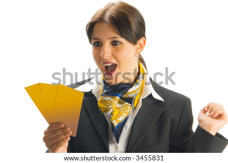 cute and young woman in black suit checking some tickets and making a winner expression