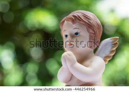 Cute angelic cupid statue valentine day - stock photo
