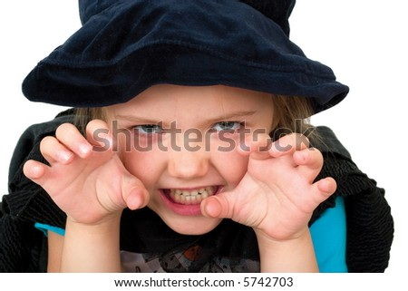 cute antic girl in halloween costume of witch