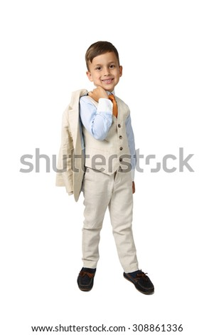 Cute Arabic looking little boy in elegant three-piece suit stands smiling - full height portrait isolated on white background - wealth and successful growing business concept - stock photo