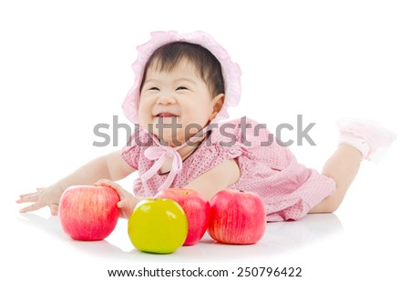 Cute asian baby girl with apples - stock photo