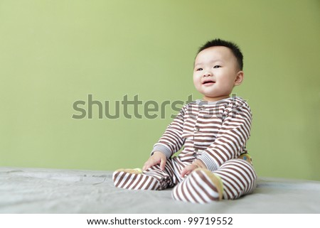 Cute asian baby with green background - stock photo