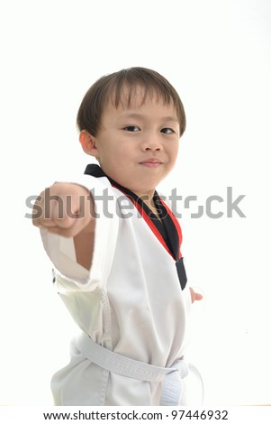 Cute asian boy with taekwondo uniform on white background. - stock photo