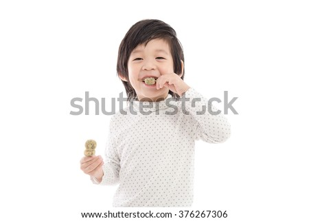 Cute asian child eating japanese dessert on white background,isolated
