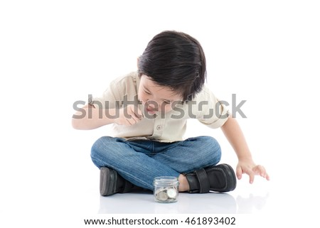 Cute Asian child saving money in glass bottle,money saving concept