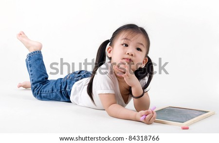 cute asian girl drawing on the chalkboard - stock photo