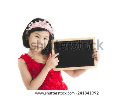Cute Asian girl in red dress holding blank blackboard isolated on white. - stock photo