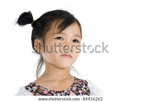 cute Asian girl looking up over white background - stock photo