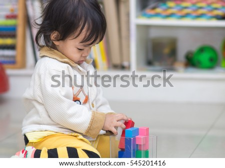 cute asian girl playing blocks