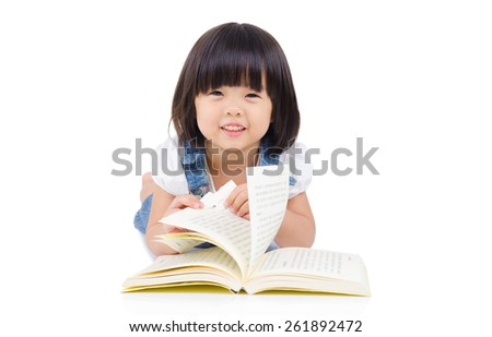 Cute asian girl reading - stock photo