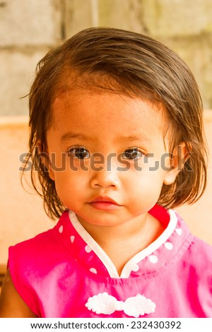 Cute asian girl wear pink chineese dress. - stock photo