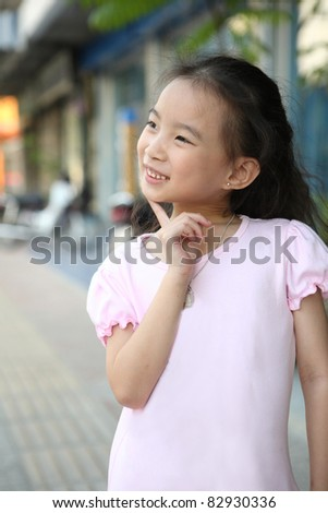 cute asian girl with thinking - stock photo