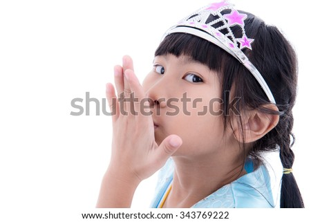 Cute Asian little princess girl in silver crown and blue dress over white
