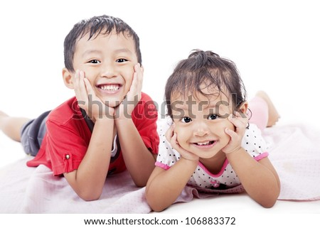 Cute asian sibling posing on white background. shot in studio