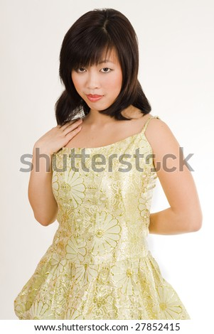 Cute asian women in gold evening dress with attractive look - stock photo