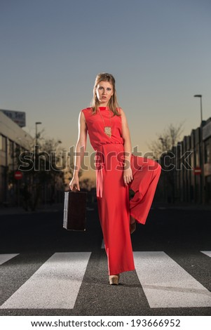 Cute, attractive woman in red dress.Trendy cover blonde girl glamorous pose with red dress