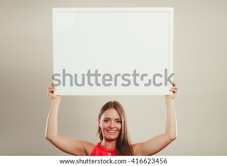 Cute attractive young woman girl in red shirt in studio with blank empty white copy space banner. Summer female fashion vogue and advertisement. - stock photo