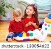cute babies playing toys at home - stock photo