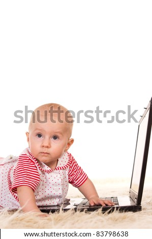 cute baby at carpet with a laptop - stock photo