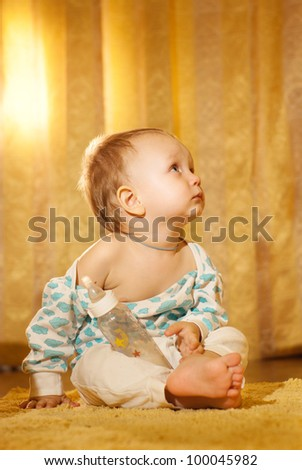 Cute baby booy looking up - stock photo