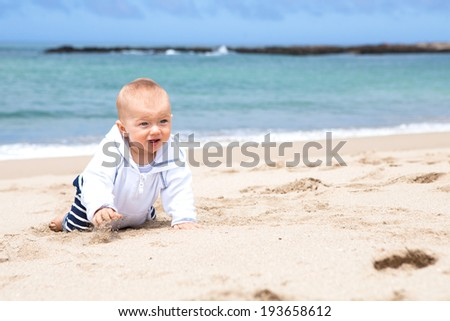 Cute baby boy crawling on the beach  - stock photo