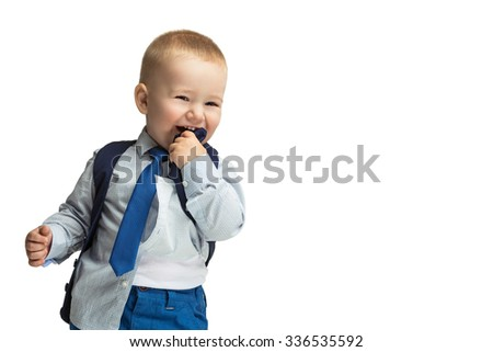 Cute baby boy in shirt, vest and tie laughing and biting his clothes. Isolated over white background. Copy cpace. - stock photo