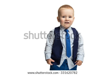 Cute baby boy in shirt, vest and tie standing and looking at camera. Isolated over white background. Copy cpace. - stock photo