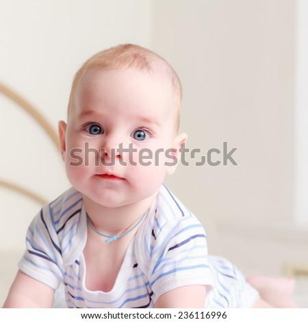 Cute baby boy looking at camera, close up - stock photo