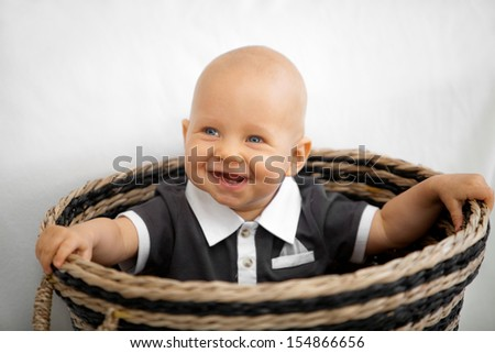 Cute baby boy playing on the floor - stock photo