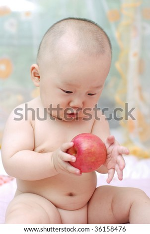 cute baby boy  playing  red apple - stock photo