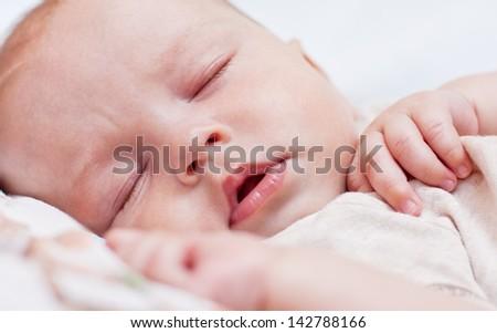 cute baby boy sleeping - stock photo