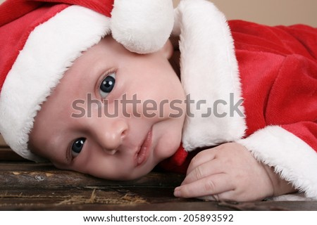 Cute baby boy wearing a christmas suit  - stock photo