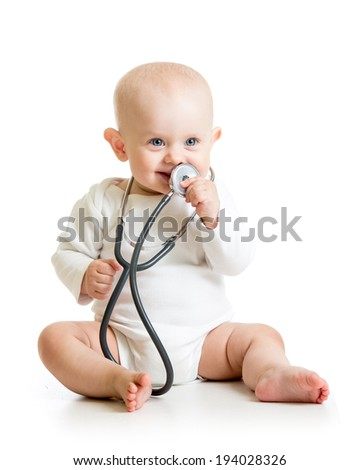 cute baby boy with stethoscope in hands - stock photo