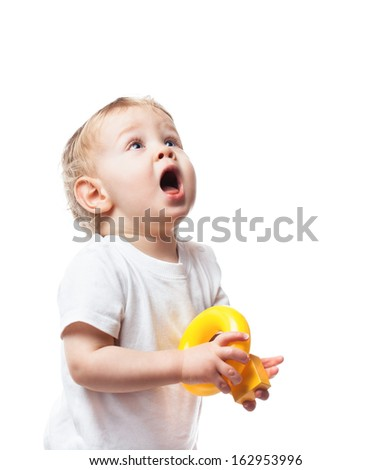 Cute baby boy with surprised expression looking to the side isolated on white. - stock photo