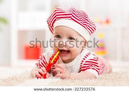 Cute baby child girl in hat having fun - stock photo