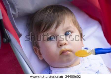 Cute baby eat - stock photo