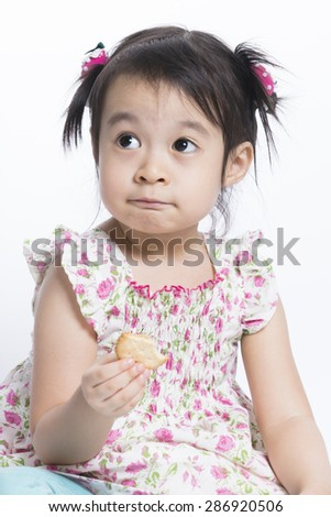 Cute baby eating cookies