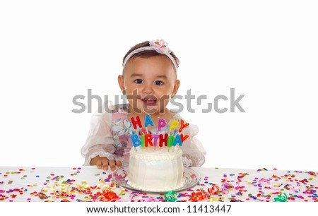 Cute baby girl and a birthday cake - stock photo