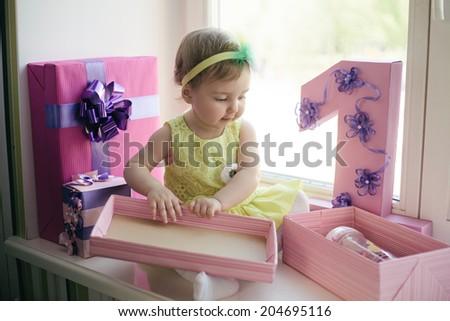 cute baby girl celebrating first birthday - stock photo
