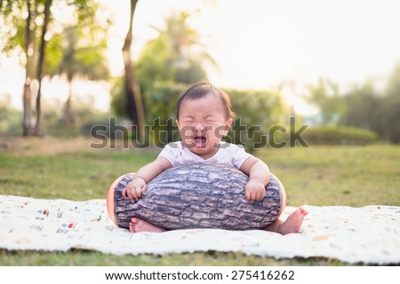 Cute baby girl crying in the park - stock photo