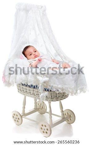 Cute baby girl in a carriage - stock photo