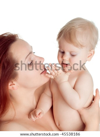 cute baby girl in a hug mother looks at her palm isolated on white - stock photo