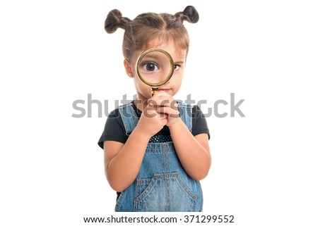 Cute baby girl  looking  through a magnifying glass.Isolated - stock photo