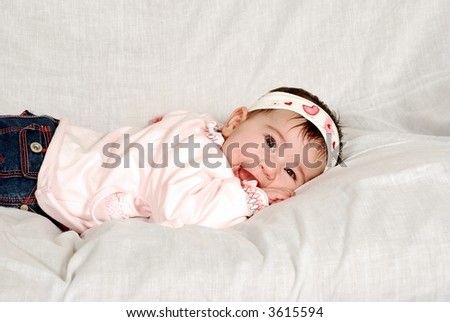 cute baby girl lying on tummy - stock photo