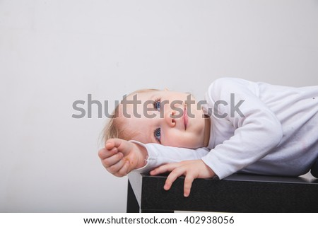 Cute baby girl lying on white background - stock photo