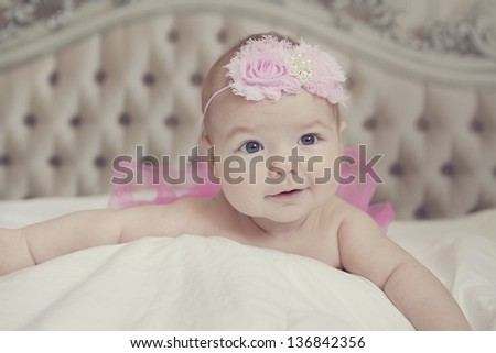 cute baby girl on the bed