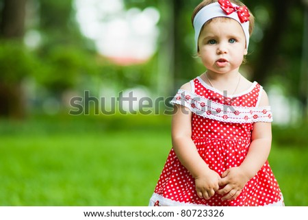 cute baby-girl outdoors - stock photo
